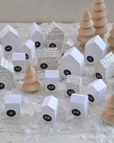 Little House Advent Calendar: A pattern for 3 sizes of paper houses, and printable number labels to make your own little advent village, and fill each house with a treat or surprise.