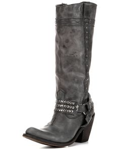 Handcrafted quality meets high fashion in Independent Boot Company's Alyssa Harness Boot. An underslung heel and studded harness give off an irresistible look. Gunmetal studs provide excellent contrast to the distressed black leather.