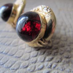 15k Yellow Gold & Cabochon Garnet Antique Earrings. 19th Century Jewelry. Victorian Carbuncle Garnets. 1880's Fine Gold Gemstone Jewelry by MaisonettedeMadness on Etsy https://www.etsy.com/listing/224860358/15k-yellow-gold-cabochon-garnet-antique