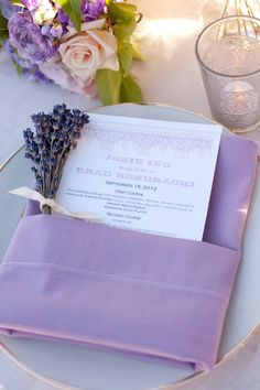 "This napkin fold is called the ""Cummerbund"" fold - great for placing your menu card inside, and I love the touch of a lavender sprig"