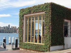 "Greenhouse facade, covered with pots of strawberry plants. Since 2008, eco-designer Joost Bakker has been building restaurants that Australian Design Review describes as ""exercises in sustainability."" 