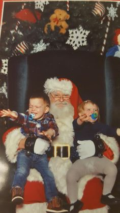 Two for one! Click through for more kids not thrilled with Santa.