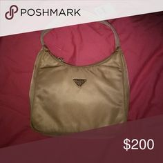 *STEAL**! NWT PRADA TESSUTO NYLON SHOULDER BAG New with tags from Neiman Marcus Prada tessuto cream colored nylon bag Comes with authenticity card FINAL PRICE IS FIRM Used ones sell for twice as much! Prada Bags