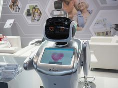 Sanbot is a humanoid robot with penguin flipper arms and a touchscreen heart…