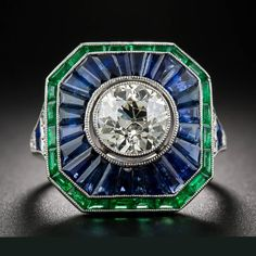 https://www.etsy.com/listing/276890640/18k-white-gold-blue-sapphire-diamond Art Deco Sapphire, Emerald and Diamond ring.