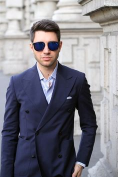 Navy double-breasted jacket, white shirt with light blue candy stripes
