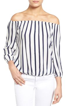 This spring-ready piece from Cupcakes & Cashmere is patterned with bold vertical stripes and finished with a cinched waist and gathered three-quarter-length sleeves.