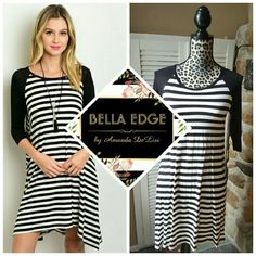 Black white stripes tunic dress 95% RAYON, 5% SPANDEX. Made in the USA. This adorable dress gives off a high-low/asymmetrical style with trendy striped pattern. Solid black sleeves, scoop neckline. Sizes small to large Bella Edge Boutique  Dresses Asymmetrical