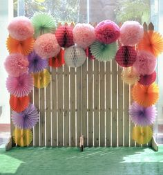 honeycomb pom poms and pinwheel photo booths