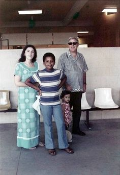 Young Barack Obama poses with his mother, Ann, half sister, Maya, and maternal grandfather Stanley Dunham in Hawaii