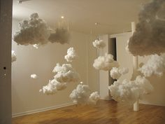 Clouds suspended from the ceiling using cotton balls