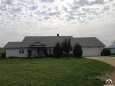 """beautiful wide open rolling hills of Kansas in every direction, Spacious rooms all have huge views, some trees, creek, pasture/ag land, 40x30 smooth cement floored Work shed plus hen house. Home is all 2x6 constructed walls and 5/8"""" roof sheathing, Wood stove is connected to house HVAC duct work so winter heat bills are practically non existent. Large finished basement safe rooms on 18.3 Pristine acres, 9 min from downtown Lawrence, just a few miles to I-70,  Call James Truscello (785)…"""
