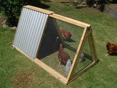 very small tractor sized for 2 birds with roost and nest box. would also be good to have for baby chick integration or a  broody hen with chicks. several views so it can be duplicated as a DIY.