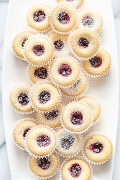 Almond Tea Cakes with Wild Blueberry Jam - A tray of Almond Tea Cake Cookies with a Wild Blueberry Jam center Source by SHEINofficial - Tea Cakes, Mini Cakes, Almond Tea, Almond Flour, Tea Cake Cookies, Cupcakes, Cookie Cakes, Jam Cookies, Spritz Cookies