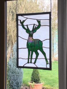 """Stag in the Mist"" a commissioned artwork made of stained glass.   Made by Brian Dickinson of #dolittleglass. Based in the U.K. Midlands.  The white whispy background gives a misty cloud like appearance. The green Stag is made from iridescent glass which looks different as light changes throughout the day.   This is my third Stag has been made for a family who have just moved into a new dream house. The first two were commissioned as wedding presents."