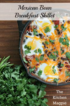 Mexican Bean Breakfast Skillet #recipe- Beans, cheese, tomatoes with baked sunny-side up eggs in a skillet. High protein, no carbs!