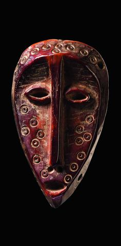 Africa | 'Lukungu' mask from the Lega people of the Democratic Republic of Congo | Ivory; reddish brown patina. H: 11.5 cm | ca. 1935 or earlier