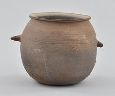 """Korean Pottery Jar with Handles, Silla Period ca. 6th-9th Century. Earthenware with overall warm gray matte surface. Two simple pointed handles, round form with wide opening and out-turned rim. Apprx. 5""""T x 7"""" from handle to handle."""
