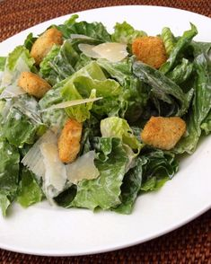 This is my favorite Caesar Salad dressing recipe. Very easy and no eggs. The idea of raw eggs freak me out. If it's too thick blend in a little olive oil.