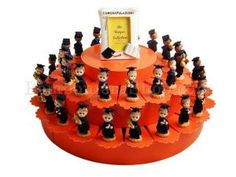 38 Slice favour cake with male graduating figurines and filled with a choice of dragees - sugared almonds - sweets -candy. A great idea for a graduation degree party celebration, italian favours favors, favor cake #bomboniere #graduation #favor http://www.bombonierashop.com/en/department/12/Favour-Cakes.html
