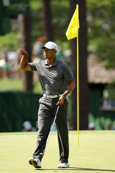 Tiger Woods reacts after sinking a putt on the third hole during the first round of the 2012 Masters Tournament