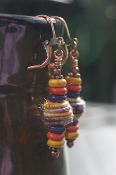 Messy Crow yarn and wood bead earrings by MessyCrow on Etsy, $18.00