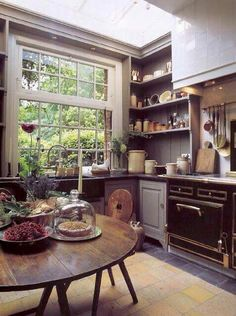 That's one cool kitchen. Love the wooden table, love the big giant window, love the shelves.