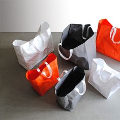 white, orange, and grey elemental bags by studio brovhn. photo source: studiobrovhn.com
