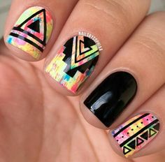 Tribal print nail art over a colorful base using the dry brush technique