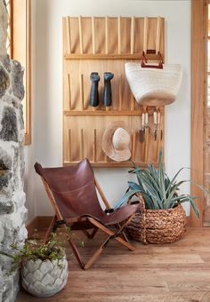 This storage rack on the wall makes for a fun design element, but it's also actually really useful. Garden necessities like boots, hats and tools are important to have easily accessible for working in the garden.