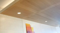 Asona Tiles in wood veneer installed into a suspended ceiling feature