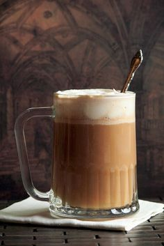 How to Make Butter Beer from Harry Potter - 4 servings  1 cup brown sugar   4 tablespoons butter   1/2 teaspoon salt   1 teaspoon apple cider vinegar   3/4 cup heavy cream, divided   Four 12-ounce bottles cream soda, chilled.