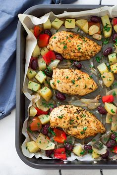 This gluten-free, paleo, simple to prep One-Pan Mediterranean Roast Chicken with potatoes, onions, red pepper