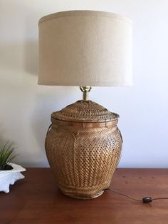 Wicker Basket Lamp / Woven Basket Table Lamp / Bohemian Rattan Lamp / 70s Jungalow Basket Lamp / Beach Cottage Large Basket Table Lamp  Gorgeous vintage wicker rattan basket large table lamp Great for the bedroom or living room in a beach cottage or a boho jungalow. Comes without lamp shade  Measures: 26 tall total 14 tall just the basket 12 diameter at the widest   CONDITION REFERENCE CHART RATING: Excellent No damages to report. Thanks for looking and check out my other listings at…
