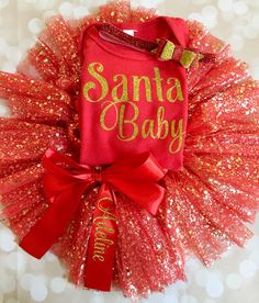 Get your baby girl ready for your family Christmas photo in this Christmas Red and Gold Bodysuit adorned with Glittery Santa Baby. This set comes with an amazing sparkling Red Tutu and is topped off with a luxorious felt bow. Everything is handmade in the USA.