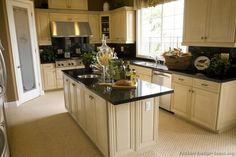 LOVE antique white kitchen cabinets with dark countertops.  Definitely can't wait to paint our cabinets in this style.