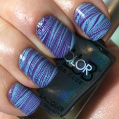 Color Club Over the Moon as a base  Watermarble done with Over the Moon, OPI Funky Dunkey, and Wet n Wild Putting on Airs with my new watermarbling tool from What's Up Nails. Topcoated with HK Girl.  #nailart #wetnwild #opi glistenandglow #hkgirl #colorclub #watermarble #watermarbling