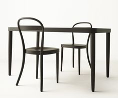 Muji by Thonet  The beech, bent wood collection  was designed by Milan-based, British designer James Irvine (creative director of Thonet) and features a single panel supporting the back of the chair, which aligns with the accompanying table top.