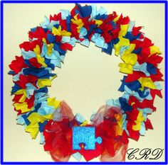 Autism Awareness Puzzle Ribbon Door Wreath with big red bow and sparkley blue puzzle piece. $35.00, via Etsy.
