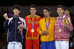 Gold: Joel Gonzalez Bonilla (Spain)  Silver: Lee Dae-hoon (South Korea)  Bronze: Alexey Denisenko (Russia)  Taekwondo - men's 58-kg class
