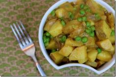 Coconut curried potatoes & peas. Simple ingredients list! But need to get coconut oil...