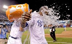 KC beats Seattle in the 10th -  Kansas City Royals' Lorenzo Cain is doused by Drew Butera after Cain hit a single to score the game-winning run during the 10th inning of a baseball game against the Seattle Mariners on Sept. 23 in Kansas City, Mo. The Royals won 4-3. - © Charlie Riedel/AP Photo