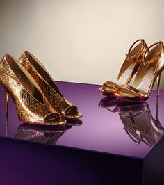 Burberry gold peep-toe pumps and platform sandals in a striking metallic finish.