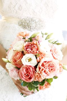 my pretty pink bouquet and the favorite part of my wedding dress-the brooch!