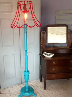 Upclycled standard lamp. Mine will probably use silk flowers on the lamp. I will make something when I get home.