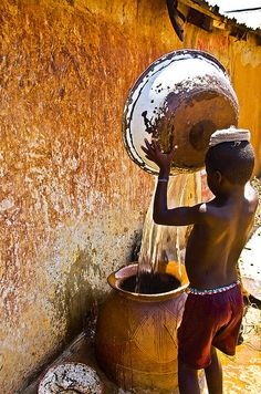 Precious water in North Ghana. Millions of people all over the world don't have access to clean, free water.