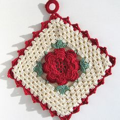 Rose potholder by Signed With an Owl, via Flickr.  Link to free pattern.