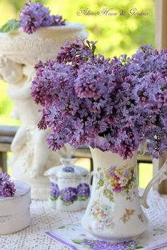 Antique Pitchers as Vases are perfect for lilacs, because they are tall enough.  Aiken House & Gardens: My Summer Porch & Romantic Country