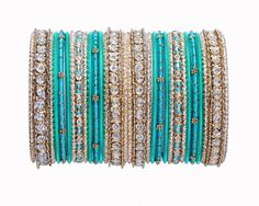 Turquoise green and golden bangle set[Regular Price:                                    $28.00                                                                    Now only:                                    $14.00]