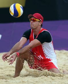 Jefferson Bellaguarda of Switzerland digs out a shot during a beach volleyball match against Brazil at the 2012 Summer Olympics, Tuesday, July 31, 2012, in London. (AP Photo/Dave Martin)